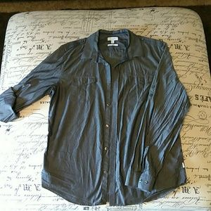 Blue Calvin Klein button down shirt.